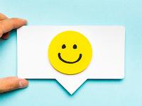 smiley face in speech bubble